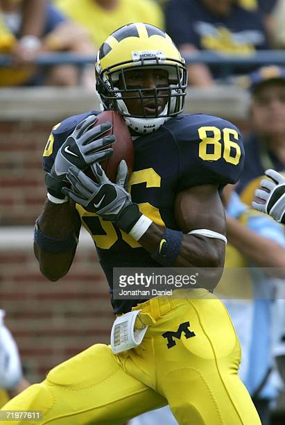 Mario Manningham of the Michigan Wolverines catches a touchdown pass in the 2nd half against the Wisconsin Badgers on September 23 2006 at Michigan...