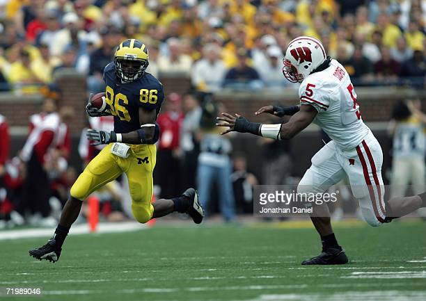 Mario Manningham of the Michigan Wolverines runs past Jamal Cooper of the Wisconsin Badgers during the game on September 23 2006 at Michigan Stadium...