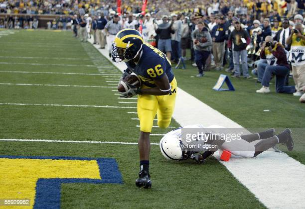 Mario Manningham of the Michigan Wolverines scores on a 33yard touchdown pass in the fourth quarter against the Penn State Nittany Lions on October...