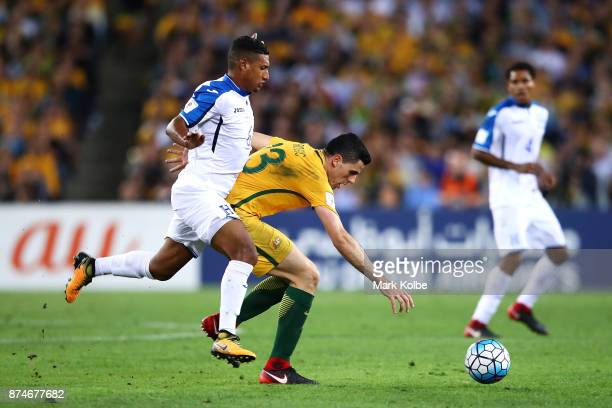 Mario Martnez of Honduras tackles Tommy Rogic of Australia during the 2018 FIFA World Cup Qualifiers Leg 2 match between the Australian Socceroos and...