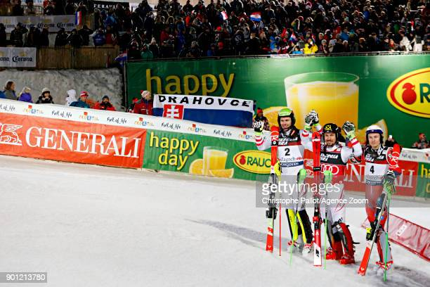 Mario Matt of Austria takes 2nd place Marcel Hirscher of Austria takes 1st place Henrik Kristoffersen of Norway takes 3rd place during the Audi FIS...