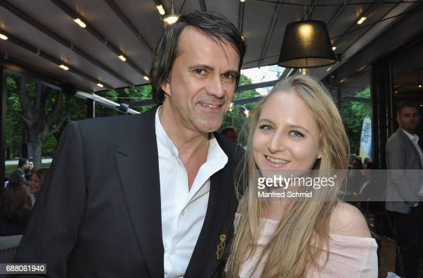 Mario Minar and Jaqueline Lugner pose during the 'Die Allee zum Genuss' restaurant opening party on May 24, 2017 in Vienna, Austria.
