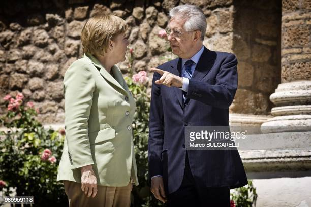 Mario Monti Italian prime minister speaks to Angela Merkel Germany's chancellor before their meeting at Villa Madama on June 22 2012 in Rome in Italy