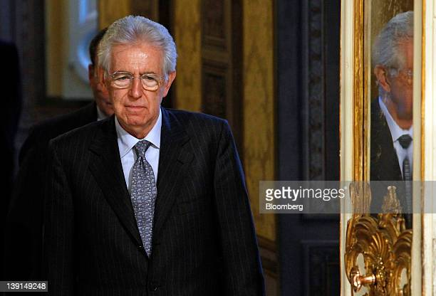 Mario Monti Italy's prime minister arrives to pose for a photograph with Jim Flaherty Canada's finance minister unseen following their meeting at the...