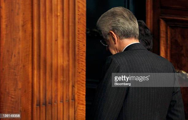 Mario Monti Italy's prime minister leaves after posing for a photograph with Jim Flaherty Canada's finance minister unseen following their meeting at...