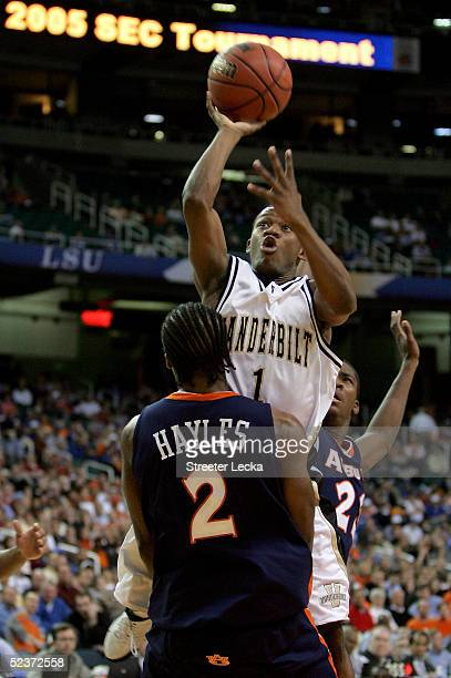 Mario Moore of the Vanderbilt Commodores shoots over Daniel Hayles of the Auburn Tigers during the first round of the SEC Men's Basketball Tournament...