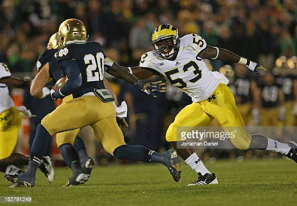 Mario Ojemudia of the Michigan Wolverines chases Cierre Wood of the Notre Dame Fighting Irish at Notre Dame Stadium on September 22 2012 in South...