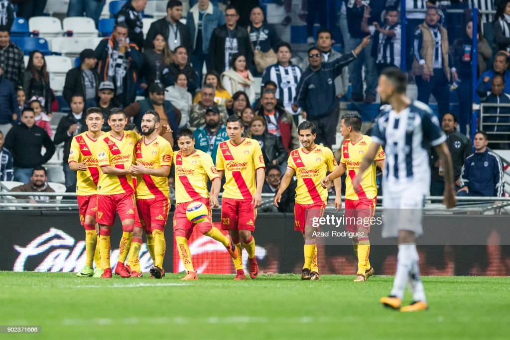 Mario Osuna of Morelia celebrates with teammates after scoring the first goal of his team during the first round match between Monterrey and Morelia as part of the Torneo Clausura 2018 Liga MX at BBVA Bancomer Stadium on January 6, 2018 in Monterrey, Mexico.
