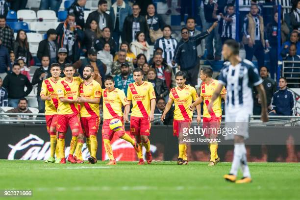 Mario Osuna of Morelia celebrates with teammates after scoring the first goal of his team during the first round match between Monterrey and Morelia...