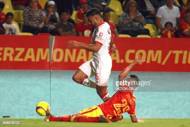 Mario Osuna of Morelia challenges Argentine Pedro Alexis Canelo of Toluca during their Mexican Clausura football tournament match at the Morelos...