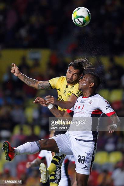 Mario Osuna of Morelia fights for the ball with Leiton Jimenez of Lobos BUAP during the 11th round match between Morelia and Lobos BUAP as part of...