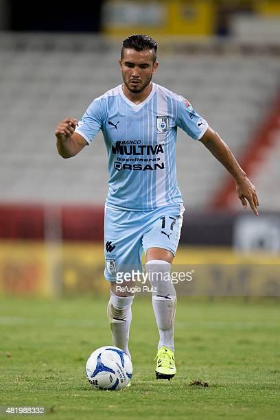 Mario Osuna of Queretaro drives the ball during a 1st round match between Atlas and Queretaro as part of the Apertura 2015 Liga MX at Jalisco Stadium...