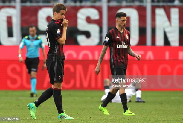 Mario Pasalic and Jose Sosa of AC Milan shows their dejection at the end of the Serie A match between AC Milan and Empoli FC at Stadio Giuseppe...