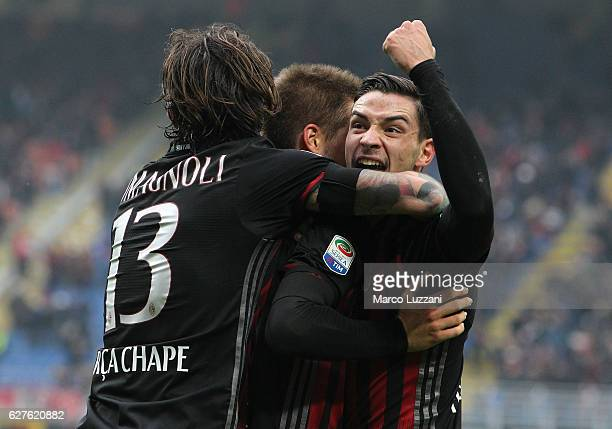 Mario Pasalic of AC Milan celebrates his goal with his teammates Mattia De Sciglio and Alessio Romagnoli during the Serie A match between AC Milan...