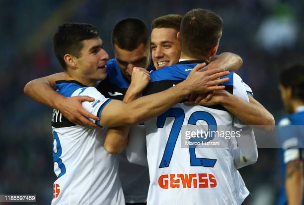 Mario Pasalic of Atalanta BC celebrates his second goal with his teammates during the Serie A match between Brescia Calcio and Atalanta BC at Stadio...