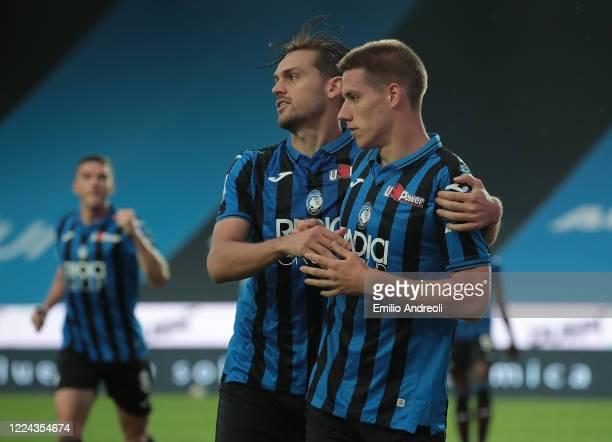 Mario Pasalic of Atalanta BC celebrates with his teammate Rafael Toloi after scoring the opening goal during the Serie A match between Atalanta BC...