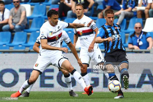 Mario Pasalic of Atalanta BC competes for the ball with Ivan Radovanovic of Genoa CFC during the Serie A match between Atalanta BC and Genoa CFC at...