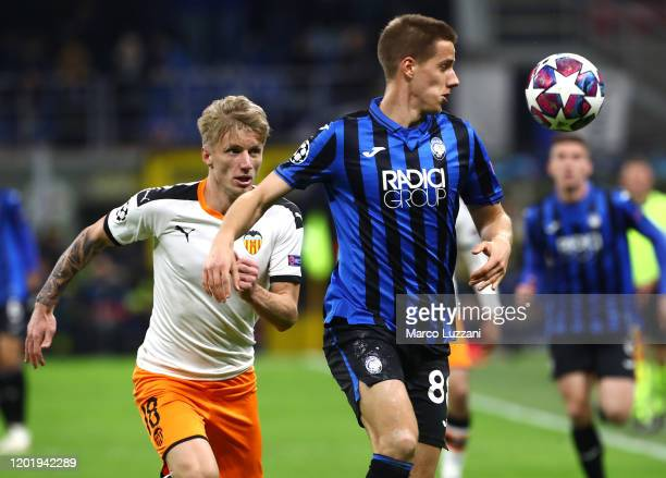 Mario Pasalic of Atalanta competes for the ball with Daniel Wass of Valencia CF during the UEFA Champions League round of 16 first leg match between...