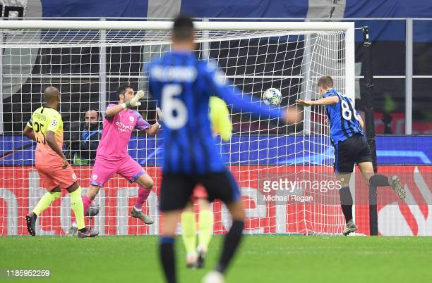 Mario Pasalic of Atalanta scores his sides first goal during the UEFA Champions League group C match between Atalanta and Manchester City at Stadio...