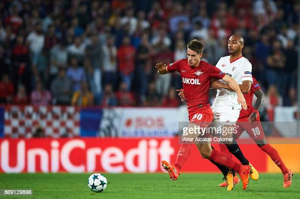 Mario Pasalic of FC Spartak Moskva competes for the ball with Steven N'Zonzi of Sevilla FC during the UEFA Champions League group E match between...