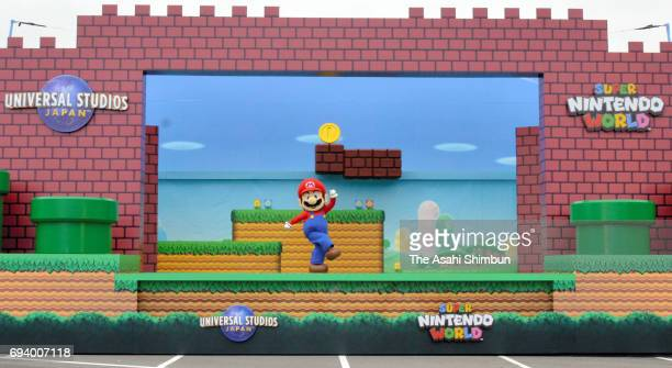 Mario perfroms during the new attraction 'Super Nintendo World' area groundbreaking ceremony at the Universal Studios Japan on June 8 2017 in Osaka...
