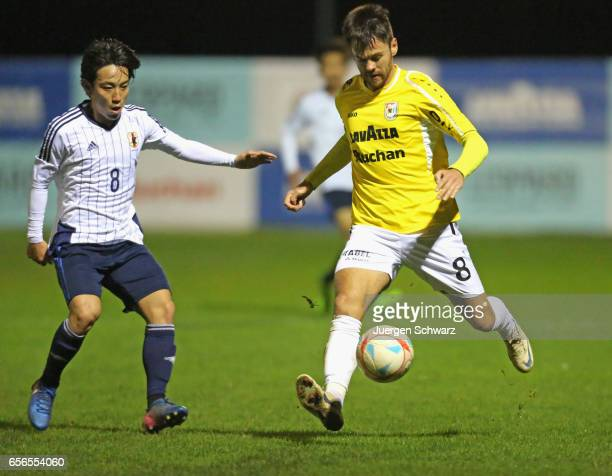 Mario Pokar of F91 controls the ball near Koji Miyoshi of Japan during a friendly soccer match between F91 Diddeleng and the Japan U20 team at Stade...