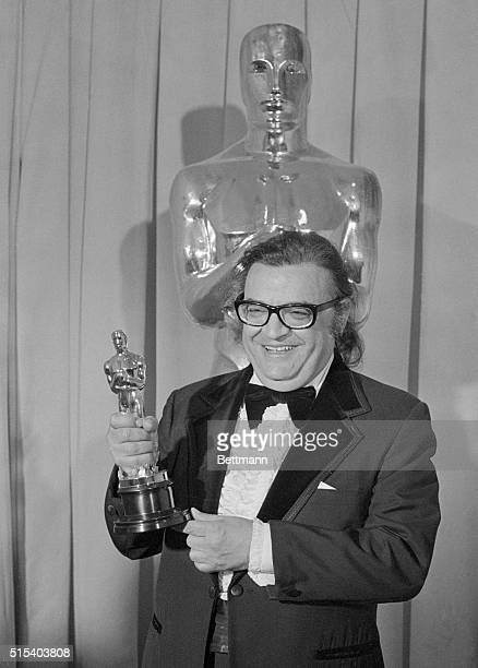 Mario Puzo proudly holds his Oscar for best screenplay for The Godfather Part II at the 47th annual Academy Awards presentation He shared this award...