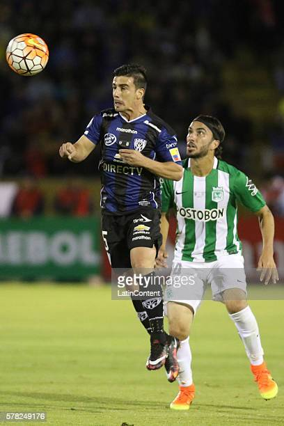 Mario Rizotto of Independiente del Valle goes for a header as Sebastián Pérez of Atletico Nacional defends during a first leg final match between...