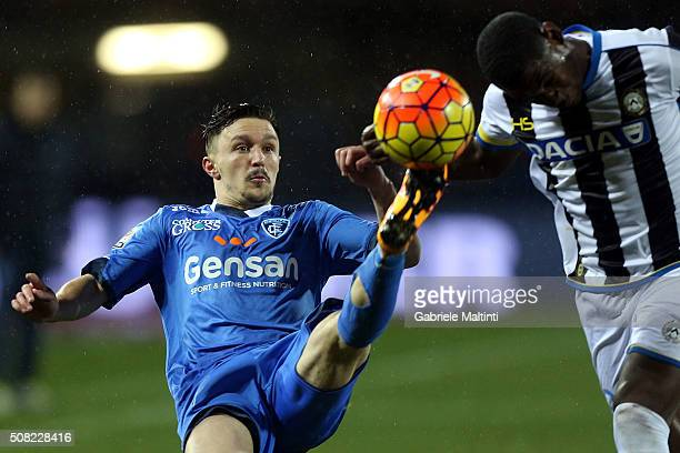 Mario Rui of Empoli FC battles for the ball with Duvan Zapata of Udinese Calcio during the Serie A match between Empoli FC and Udinese Calcio at...