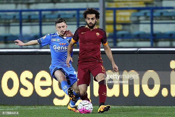 Mario Rui of Empoli FC battles for the ball with Mohamed Salah of AS Roma during the Serie A match between Empoli FC and AS Roma at Stadio Carlo...