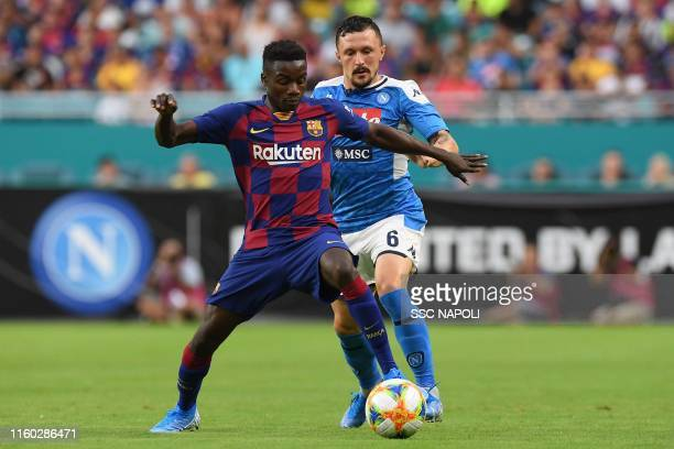 Mario Rui of Napoli fights for the ball with Moussa Wagué of Barcelona during the preseason friendly match between FC Barcelona and SSC Napoli at...