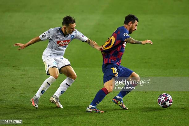 Mario Rui of SSC Napoli battles for possession with Lionel Messi of Barcelona during the UEFA Champions League round of 16 second leg match between...