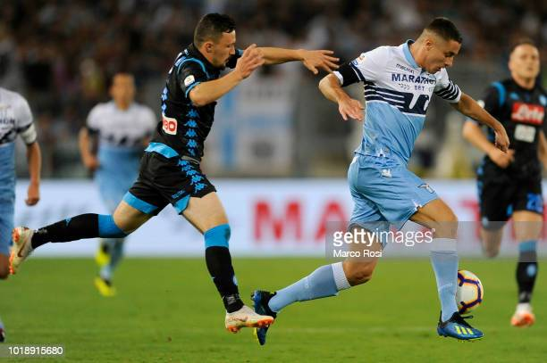 Mario Rui of SSC Napoli competes for the ball with Adam Marusic of SS Lazio during the serie A match between SS Lazio and SSC Napoli at Stadio...