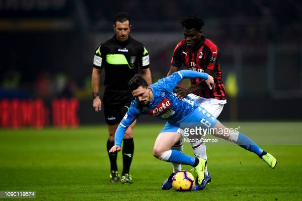 Mario Rui of SSC Napoli competes for the ball with Franck Kessie of AC Milan during the Serie A football match between AC Milan and SSC Napoli The...