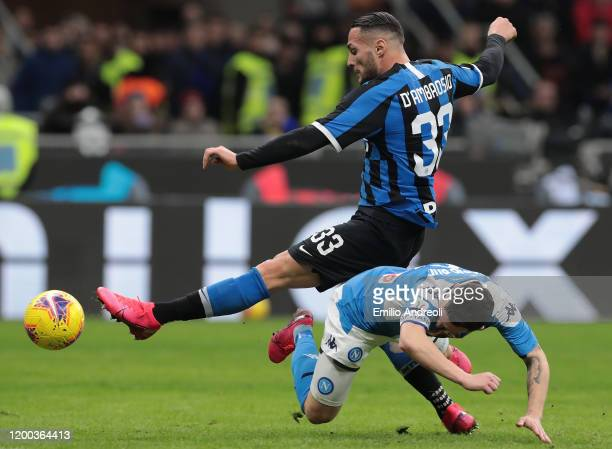 Mario Rui of SSC Napoli is challenged by Danilo D Ambrosio of FC Internazionale during the Coppa Italia Semi Final match between FC Internazionale...