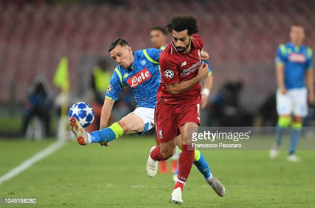 Mario Rui of SSC Napoli vies Mohamed Salah of Liverpool during the Group C match of the UEFA Champions League between SSC Napoli and Liverpool at...