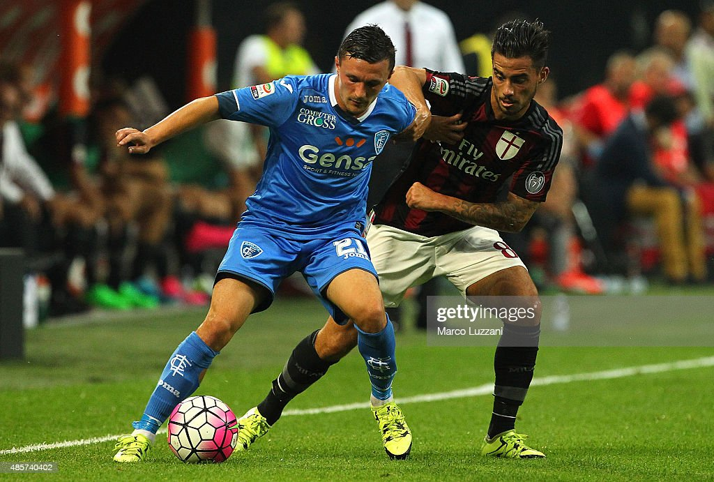 Mario Rui Silva Duarte of Empoli FC competes for the ball with Jesus Joaquin Fernandez Saenz Suso of AC Milan during the Serie A match between AC Milan and Empoli FC at Stadio Giuseppe Meazza on August 29, 2015 in Milan, Italy.