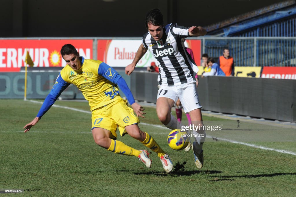 Mario Sampirisi (L) of Chievo Verona competes with Alessandro Matri of Juventus during the Serie A match between AC Chievo Verona and Juventus FC at Stadio Marc'Antonio Bentegodi on February 3, 2013 in Verona, Italy.