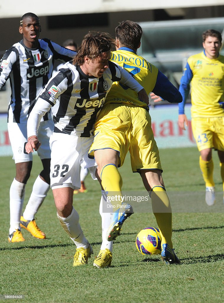 Mario Sampirisi (R) of Chievo Verona competes with Alessandro Matri of Juventus during the Serie A match between AC Chievo Verona and Juventus FC at Stadio Marc'Antonio Bentegodi on February 3, 2013 in Verona, Italy.