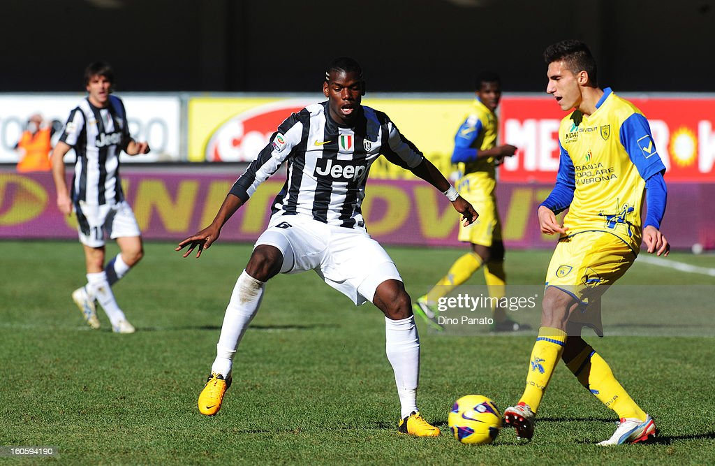 Mario Sampirisi (R) of Chievo Verona competes with Paul Pogba of Juventus during the Serie A match between AC Chievo Verona and Juventus FC at Stadio Marc'Antonio Bentegodi on February 3, 2013 in Verona, Italy.