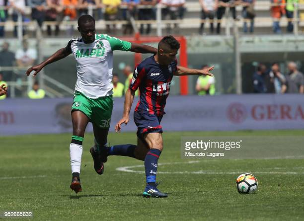 Mario Sampirisi of Crotone competes for the ball with Khouma Babacar of Sassuolo during the serie A match between FC Crotone and US Sassuolo at...
