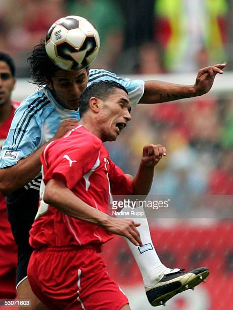 Mario Santana of Argentina heads before Anis Ayari of Tunisia during the FIFA Confederations Cup Match between Argentina and Tunisia on June 15 2005...