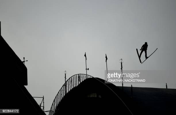 Mario Seidl of Austria competes in trial jump of the nordic combined men's team Gundersen LH/4x5km Jumping competition at the Alpensia ski jump...