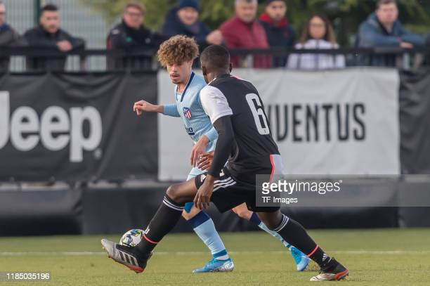 Mario Soriano of Atletico Madrid and Paolo Gozzi Iweru of Juventus U19 battle for the ball during the UEFA Youth League match between Juventus U19...