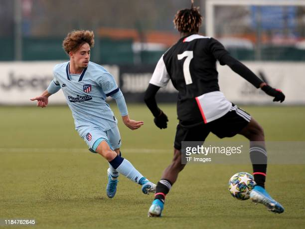 Mario Soriano of Atletico Madrid U19 and Mamadou Kaly Sene of Juventus Turin U19 battle for the ball during the UEFA Youth League match between...