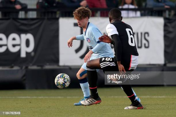 Mario Soriano of Atletico Madrid U19 and Paolo Gozzi Iweru of Juventus Turin U19 battle for the ball during the UEFA Youth League match between...