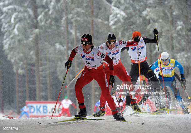 Mario Stecher of Austria competes in the Gundersen 10km Cross Country event during day two of the FIS Nordic Combined World Cup on January 3 2010 in...