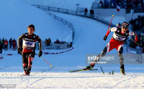 Mario Stecher of Austria crosses the finish line ahead of Tino Edelmann of Germany to win the gold medal in the Nordic Combined Team 4x5km race...