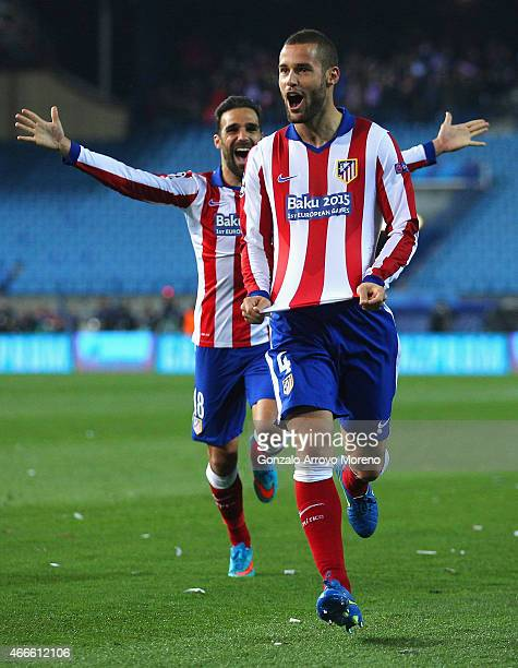 Mario Suarez of Atletico Madrid celebrates scoring the opening goal during the UEFA Champions League round of 16 match between Club Atletico de...
