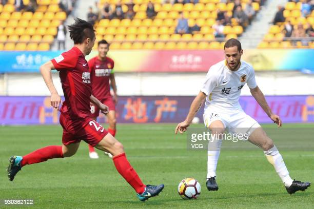 Mario Suarez of Guizhou Hengfeng and Ren Hang of Hebei China Fortune vie for the ball during the 2018 Ping An Chinese Football Association Super...